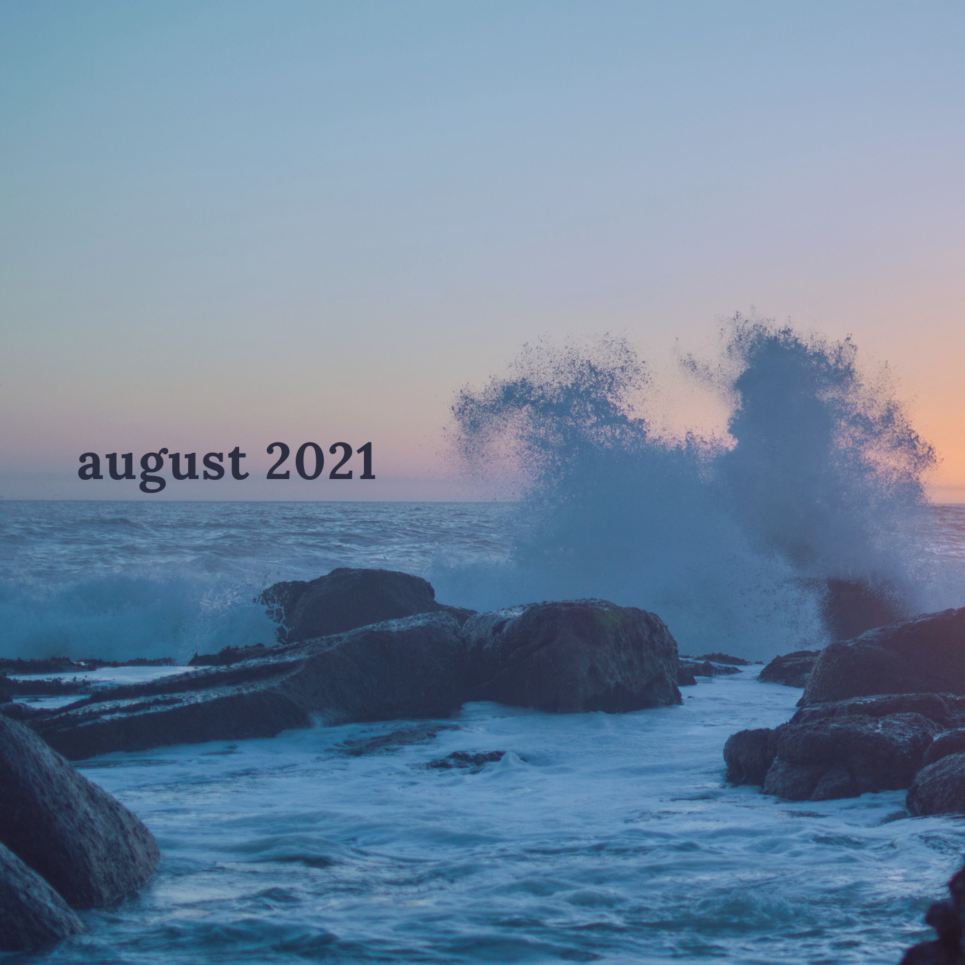a square image of the tide coming into shore against large rocky outcroppings with a tall spray reading august 2021